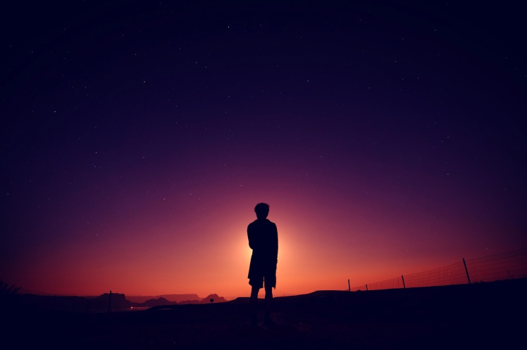 silhouette-of-boy-standing-at-the-end-of-dusk.jpg